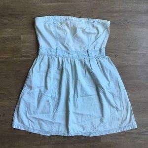 Sleeveless chambray dress with pockets